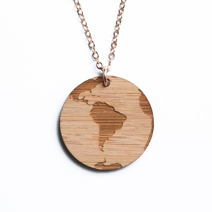 South America map necklace, etched into eco-friendly FSC certified bamboo (using a laser burner), on a recycled rose gold plated sterling silver chain.