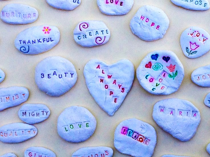 Pasadena Villa® Orlando Residents Enjoy Social Integration through Art Adventures: Affirmation Stones. The stones were created with a white air dry clay and letter stamps and permanent markers were used for color. When dry, the affirmation stones were sprayed with a protective glaze.