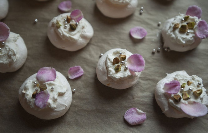 ... rose-scented meringue nests, heaped with cardamom whipped cream and