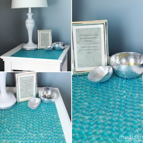 DIY Tile Table with Glass Gems. You can turn a boring old side table into something beautiful and seemingly expensive with a package of glass gems or stones at the Dollar Store. It's really a great project for sprucing up your home decor.