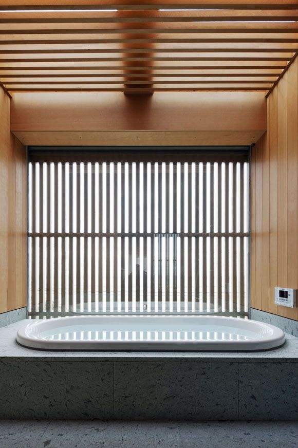 The Art of the Japanese Bath | House in Shioya  by Mitsumasa Sadakata / uemachi laboratory.  Light is filtered through timber slats covering the ceiling and glazing offering privacy and texture. When the window is open, there's an unobstructed view to the Seto Inland Sea.