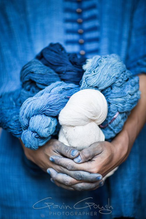 A man holding balls of yarn dyed with indigo at the Indigo Dyeing Factory, Sakhon Nokhon, Thailand. Photograph by Gavin Gough.