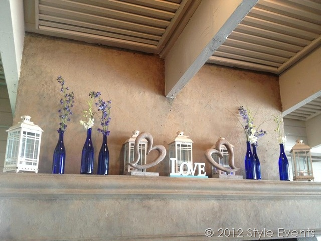 vintage nautical wedding decor - love the blue bottles