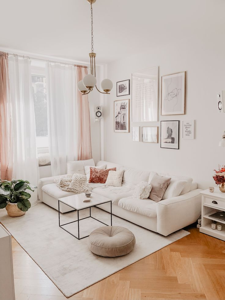 White parisian livingroom with boho elements and red decor