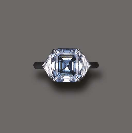 AN EXQUISITE FANCY VIVID BLUE DIAMOND RING   Centering upon a rectangular-cut fancy vivid blue diamond, weighing approximately 3.77 carats, flanked on either side by epaulette-cut diamonds, mounted in platinum