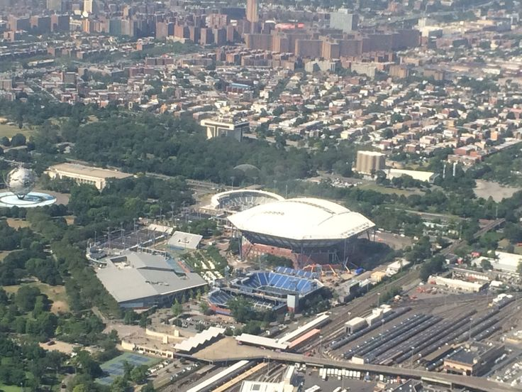 Above Arthur Ashe Stadium and the Billie Jean King National Tennis Center (home of the US Open) after taking off from LaGuardia Airport. #nyc #newyorkcity #bigapple #tennis #usta #tennis #travel #aerial #usopen