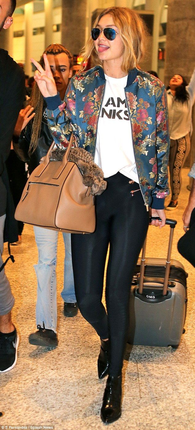 Flower power! Gigi Hadid touches down in Toronto in floral jacket giving the peace sign to adoring fans as she poses for selfies | Daily Mail Online