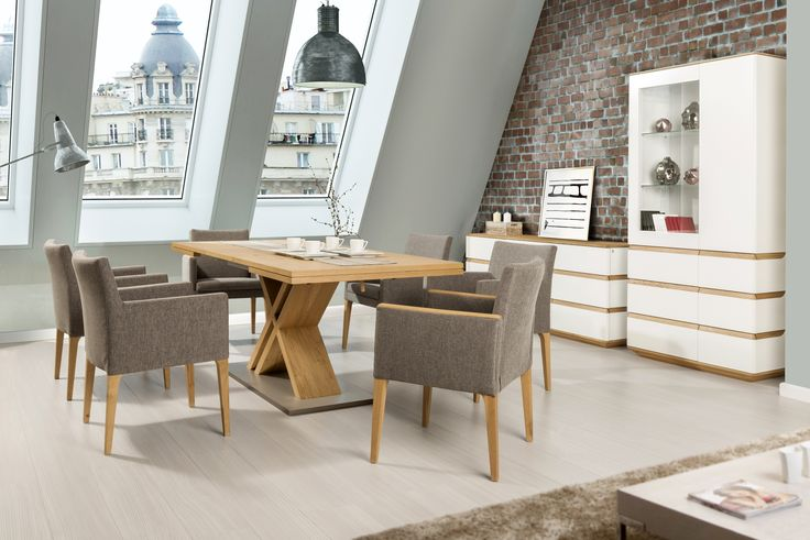 Modern dining room with oak table with steel base. #KloseFurniture #woodentable