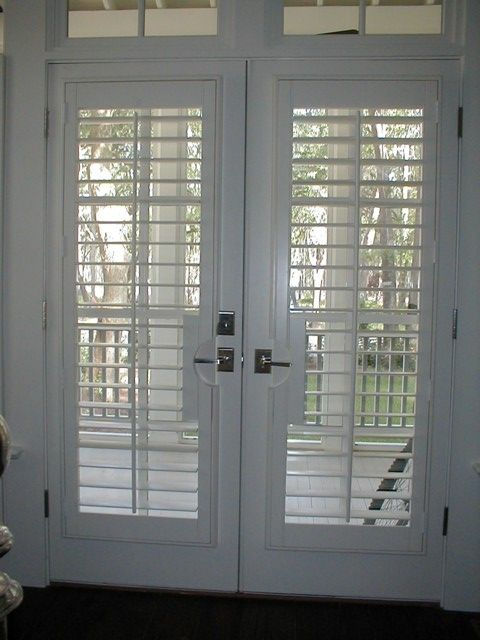 Plantation shutter french door google search morocco for Spanish style interior shutters