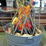 Fake Fire Pit - made with a fan, streamers, sticks.... fun!
