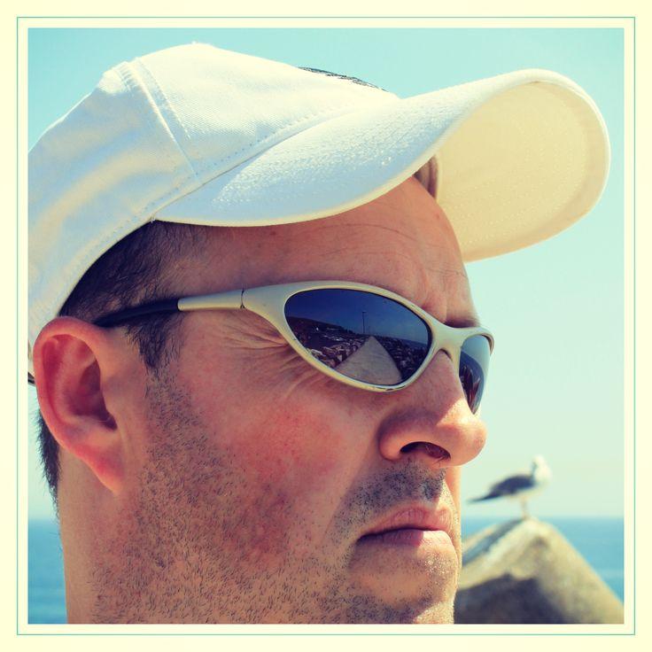 Reflection on the sunglasses: the lighthouse of Sesimbra. Farol de Sesimbra Pontão.