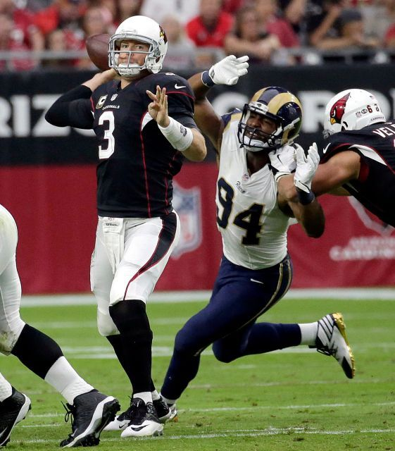 Rams vs. Cardinals Updated October 2, 2016:  17-13, Rams  -     Arizona Cardinals quarterback Carson Palmer (3) throws under pressure from Los Angeles Rams defensive end Robert Quinn (94) during the first half of an NFL football game, Sunday, Oct. 2, 2016, in Glendale, Ariz.