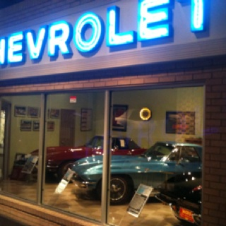 Vintage Chevy dealership with Corvettes in the showroom window!