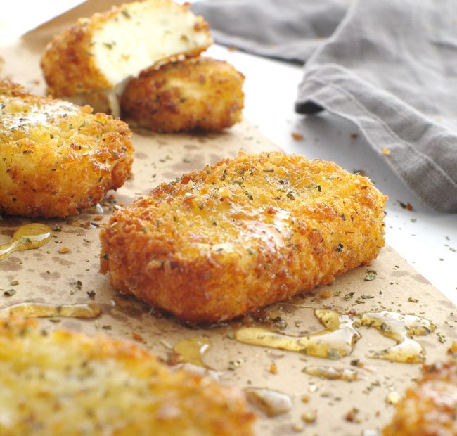 Crispy Fried Halloumi Recipe, perfect as part of a mezze platter or served with drinks. Soft squeaky cheese coated in a golden oregano crumb - delicious!