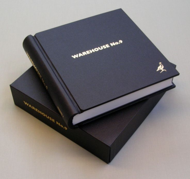 Distillery visitors book with gold logo embossing and custom storage/presentation box.