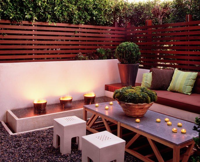 I like the mix of concrete, wood, and plants to create a privacy wall/fence.  We need this for our backyard!