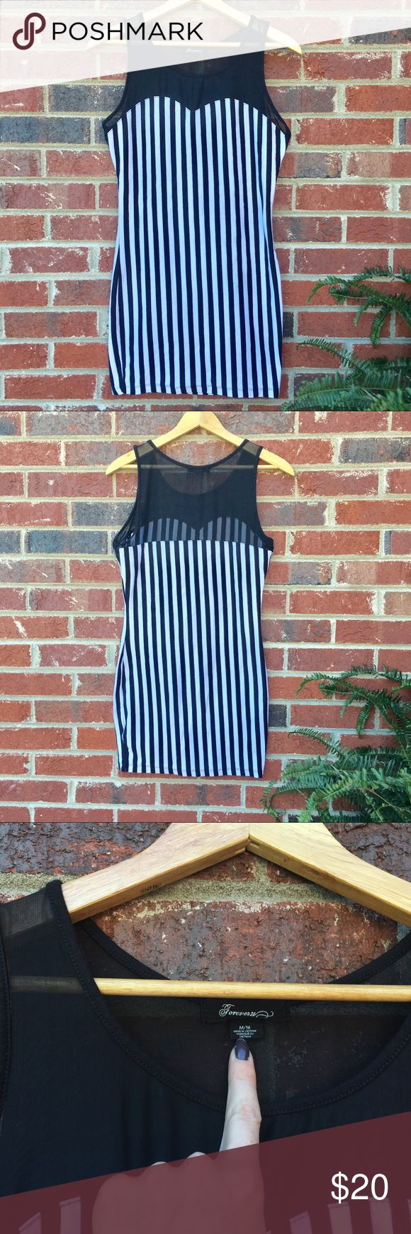 Striped Bodycon Dress Excellent condition, worn once. Black and white stripes. Listed as size medium but definitely fits a small! Soft t-shirt material. Stretchy and very flattering! Mesh top. No zippers, easy to dress in! Forever 21 Dresses Mini