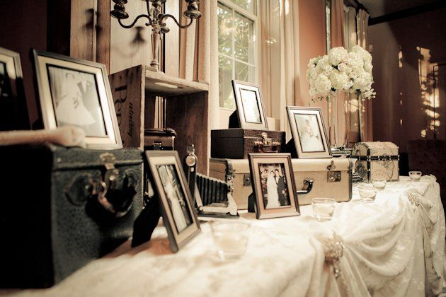 Collection of guests, family, and ancestor wedding photos on display. A unique and sentimental idea for a mantel.