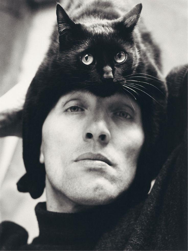"""(German photographer Herbert Tobias and his cat, Tobias.) * * TOBIAS: """" HE PUTS…"""