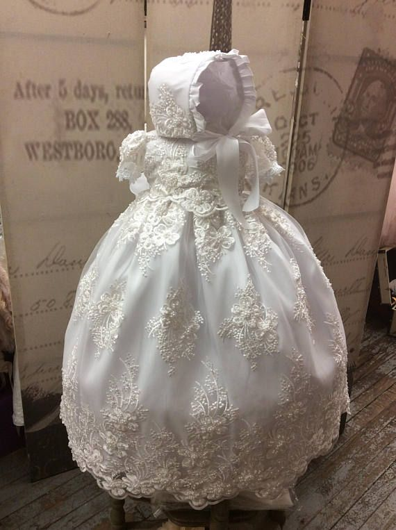Christening gown, we make all of our gowns in our studio to insure quality! Our PERLA gown Is our new addition to our collection of christening gowns, Bib: $30.00 Shoes silk:30.00 Laceshoes: $45.00 Silk and lace blanket: $110.00 Headband: $25.00 Note: before you order check