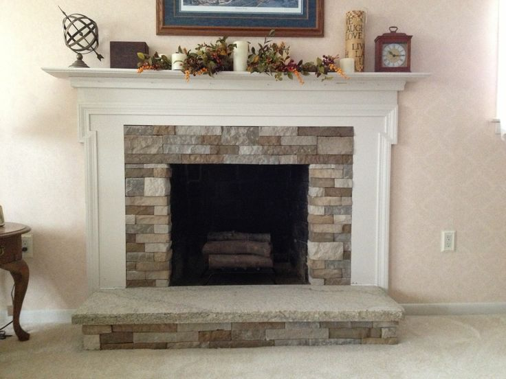 Removed two bottom rows of Air Stone that were left without adhesive,  placed custom cut - 17 Best Ideas About Granite Hearth On Pinterest Wood Burner