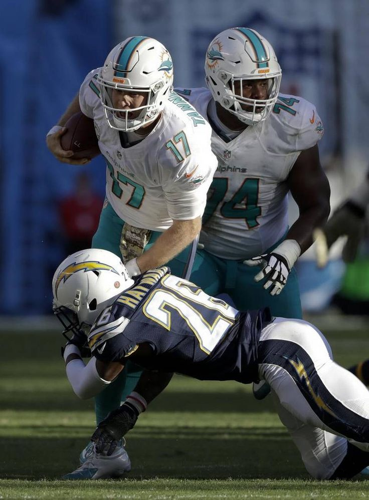 Dolphins vs. Chargers:  31-24, Dolphins  -  November 13, 2016  -     Miami Dolphins quarterback Ryan Tannehill is tackled by San Diego Chargers cornerback Casey Hayward during the second half of an NFL football game in San Diego on Nov. 13, 2016. Gregory Bull AP
