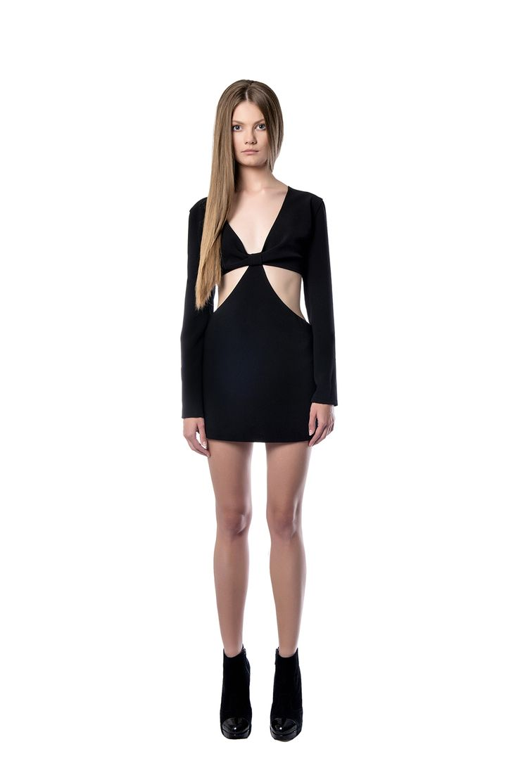 Long sleeved mini black dress   Long - sleeved dress with side cut - outs made of black crepe. It shows off the body with its short length and cut in the waist and back. The dress also has a cute bow that ties in the back.