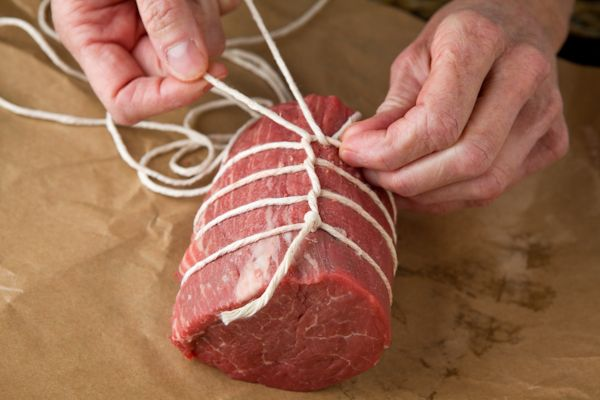 How to tie, sear and roast and beef tenderloin.