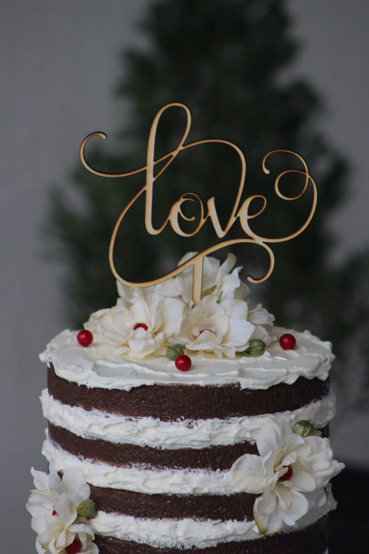 Rustic LOVE Wedding Cake topper - Wooden cake topper - Engagement Cake topper by WeddingPros on Etsy https://www.etsy.com/listing/222513928/rustic-love-wedding-cake-topper-wooden