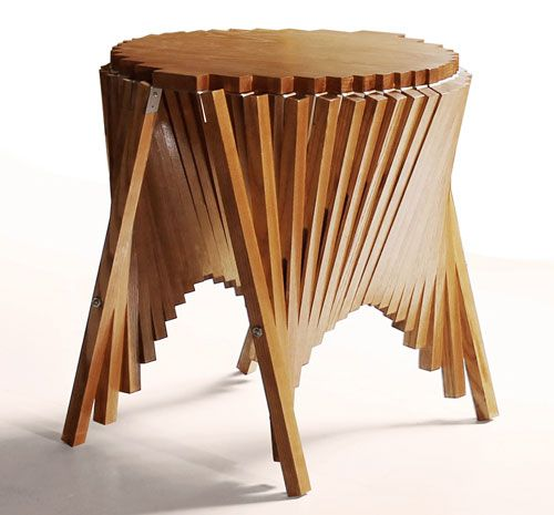 The Rising Furniture line is some brilliantly designed furniture by Robert van Embricqs. The latest in the collection is the Rising Side Table where the piece goes from flat to a completely unexpected end table.