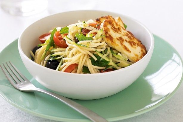 Salty golden haloumi stars with tomatoes, olives and zucchini in lemon-infused pasta.