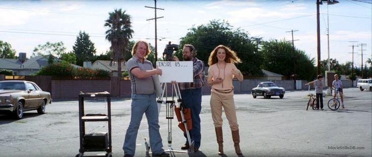 Boogie Nights publicity still of Philip Seymour Hoffman, Julianne Moore & Ricky Jay