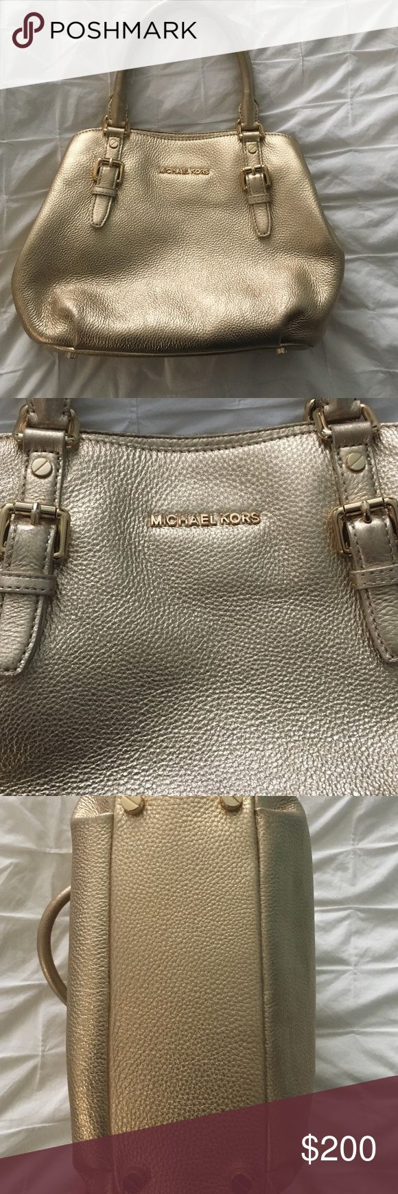 Gold Micheal Kors handbag Beautiful, gold, leather bag in Great condition. Bought at Nordstrom. Used minimally. One stain on interior, shown in pictures. Michael Kors Bags