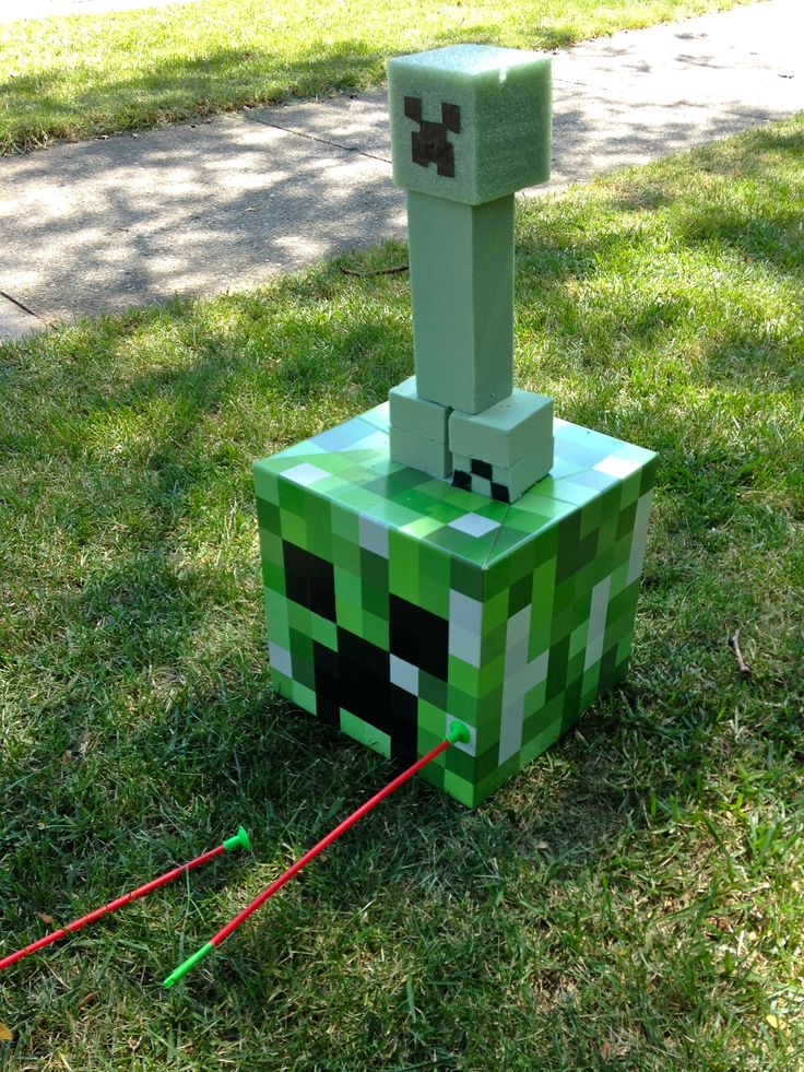Knock Over the Creeper: I bought some green floral styrofoam from the dollar store and made a creeper from it. Then using a simple plastic bow and arrow with a suction cup (bought from the party store), each kid took turns trying to knock over the creeper. I had them keep track of how many block they knocked over (it was made of four blocks) and the one who knocked over the most blocks was the winner, with everyone else in order behind him.