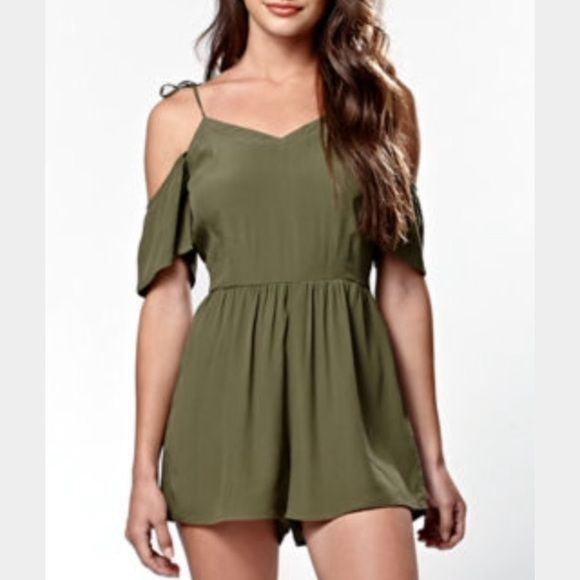 Kendall & Kylie romper Never worn, tag got ripped off. Kendal & Kylie olive romper, ties on the shoulder, zipper on the side. Size XS Kendall & Kylie Pants Jumpsuits & Rompers