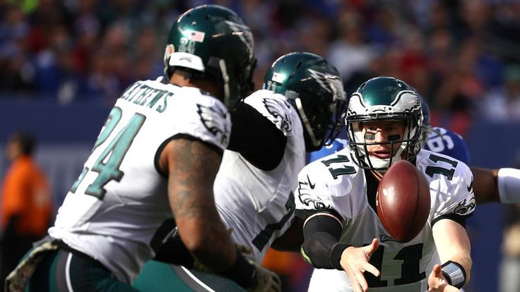 Eagles vs. Giants:  28-23, Giants  -  November 6, 2016  -    Carson Wentz #11 of the Philadelphia Eagles flicks the ball to Ryan Mathews #24 against the New York Giants during the first half of the game at MetLife Stadium on November 6, 2016 in East Rutherford, New Jersey.