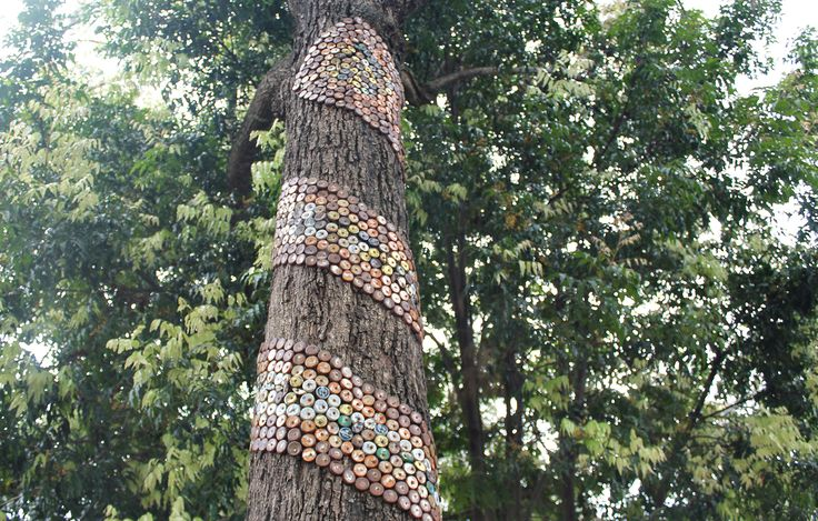 Decorate a tree with over 1000 bottle caps. Surprisingly effective.