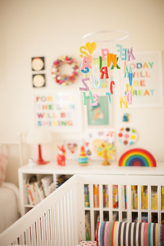love the mobile and all the primary colors in this nursery