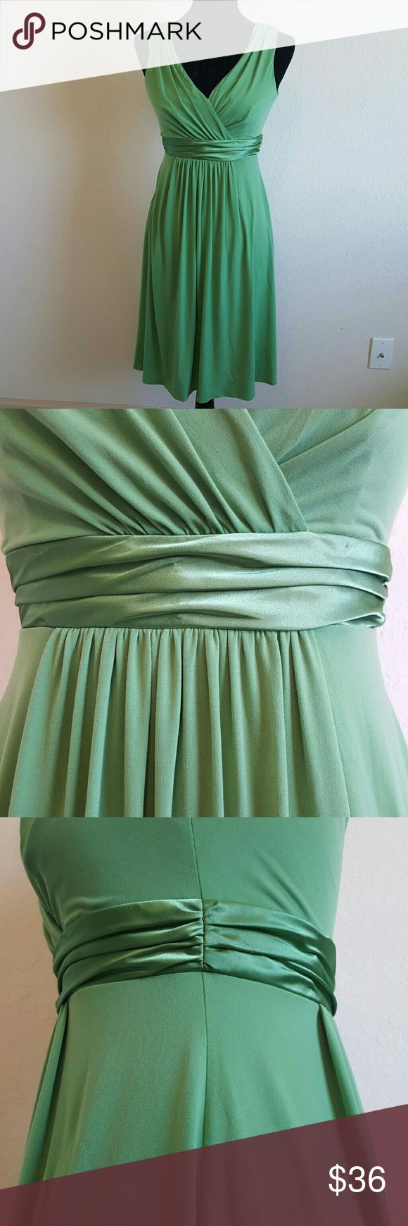 EUC  Short Sleeveless Jersey Bridesmaid Dress Short Sleeveless Jersey Bridesmaid Dress with Charmeuse Waist Band ?  Size 2 Excellent Pre-owned condition! Clover green *  Style: E44239 Comfortable and stylish, this jersey dress is a great option for your bridemaids and has plenty of wear-again potential. Sleeveless tank bodice features elegant V-neckline. Charmeuse trim highlights the waist. Jersey fabric flows gracefully for a look that is soft and chic. Back zip. Imported polyester blend…