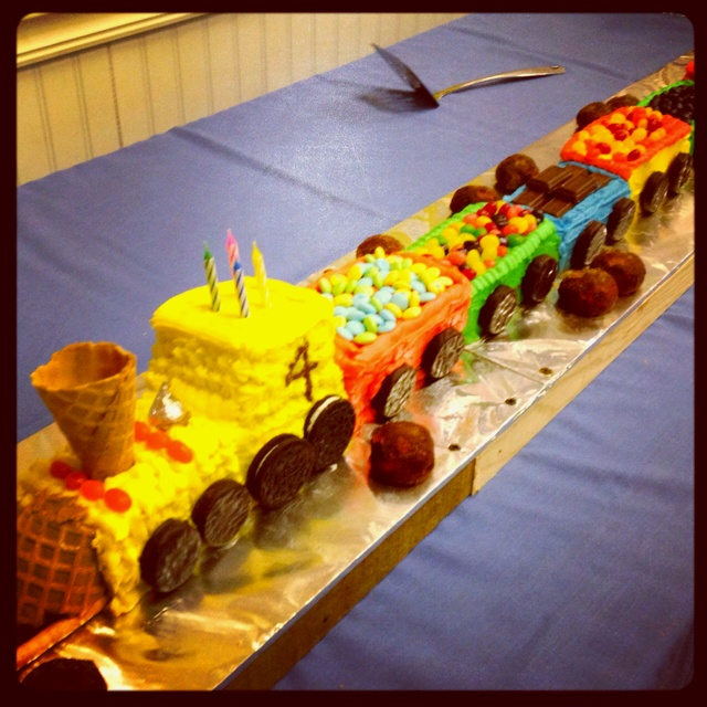 8 mini loaf train cars, 1 8x8 pan made into the engine. York patties for wheels (plus two Oreos for engine). Explosion of candy on top. Cocoa covered cake balls for rocks.