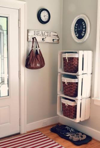 Wall mounted crates painted white with rattan storage baskets creates interesting shelving as well as providing lots of storage space.   Antique Fruit Crates €20 / New Crates €15 available at www.woontante.com