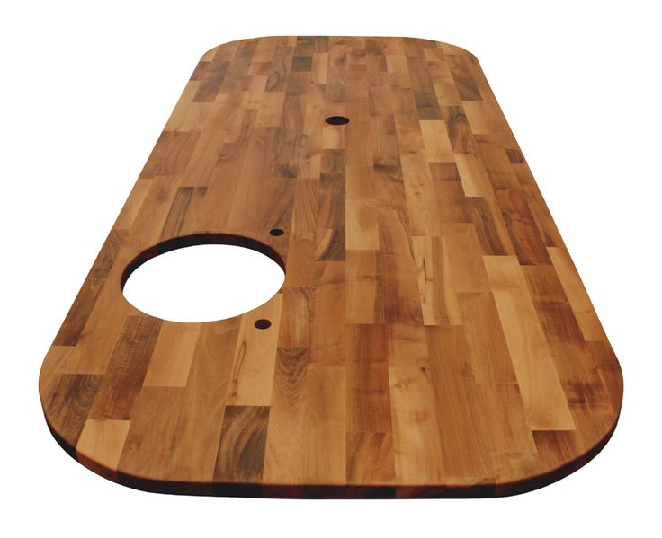 This large Deluxe Walnut worktop was fabricated by our own team, and now features an undermounted sink cut out, four 360mm radius corners, tap holes and additional hole cut out to accommodate a pop-up power outlet. http://www.worktop-express.co.uk/wood_worktops/deluxe_walnut_worktops.html