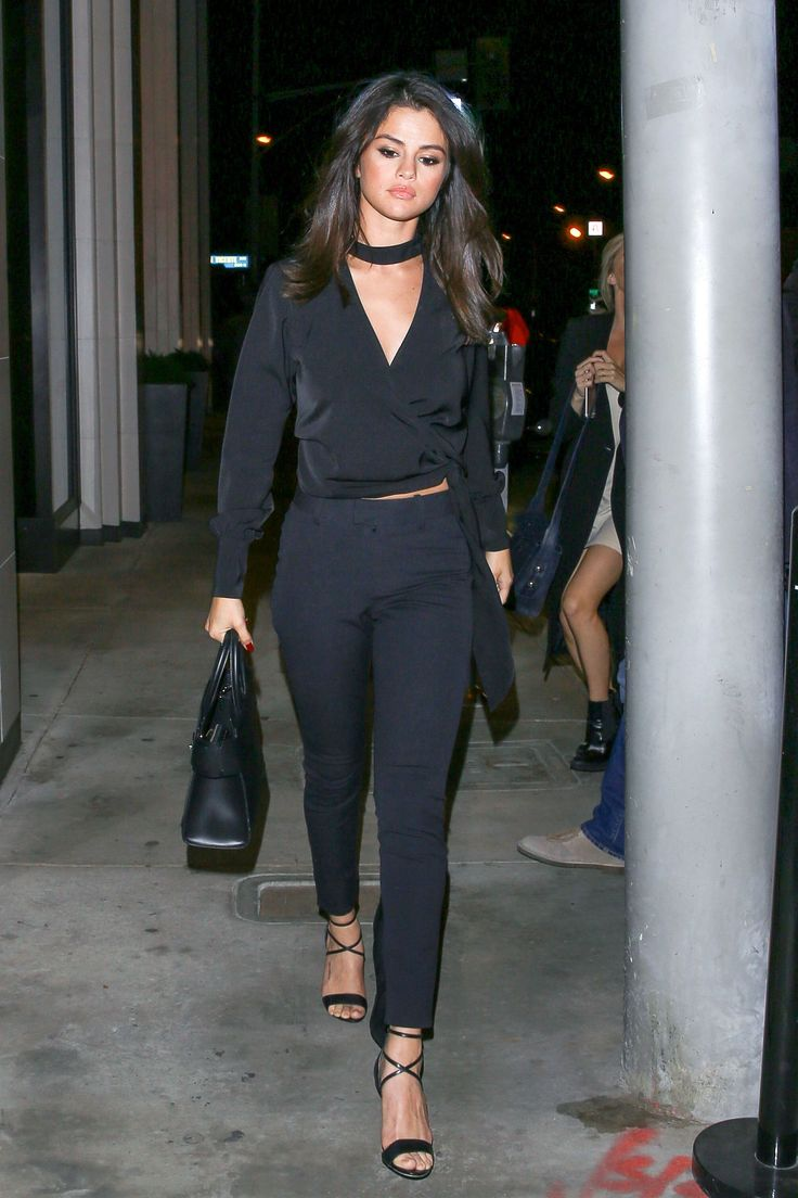 Selena Gomez in L'Academie shirt, AYR pant, Givenchy bag and Brian Atwood shoes