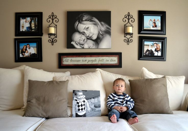 This is kind of how I'm going to setup the big wall in our living room. Family portrait in the middle, surrounded by individual photos of the kids. Maybe a wedding or engagement photo. With a nice quote underneath (or above) te family photo.