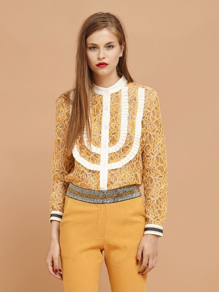 Yellow lace button-up shirt with subtle blue metallic thread details throughout. Features a contrasting white pleated bib detail and metallic elasticated cuf...