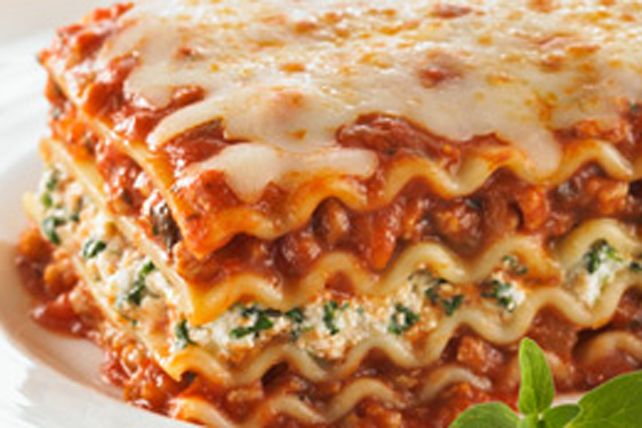 This twist on the classic lasagna is sure to become a new family favourite.  Layered with pasta, a robust pasta sauce, melted cheese and dark green spinach, this oven-baked casserole is easier to make than you might think. Try it tonight. You won't be disappointed.