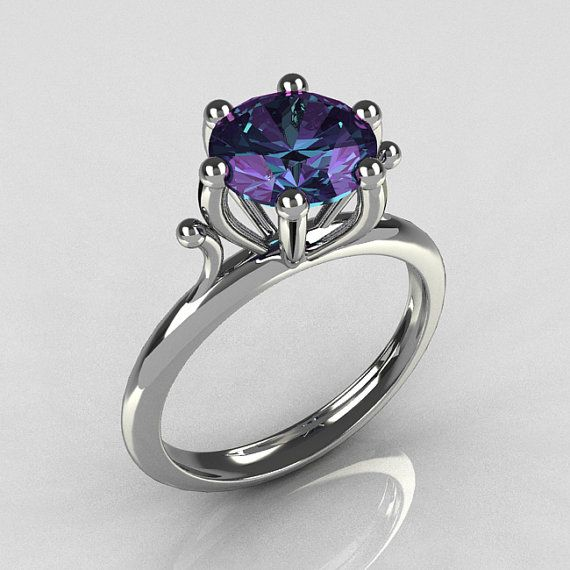 I love alexandrite, I love this organic prong setting and I love the asymmetry of the one prong that didn't make it to hold up the stone.