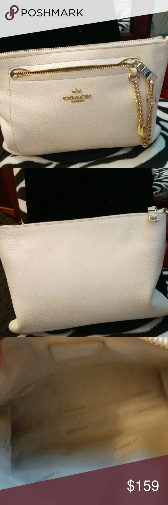 Coach Clutch Outside looks like new inside looks dirty were I carry all my makeup in it still looks great i like carrying this large wristlet in bigger bag put all my stuff in it do its not loose in my bags Coach Bags Clutches & Wristlets