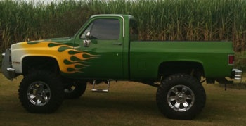 flame painted green pickup truck