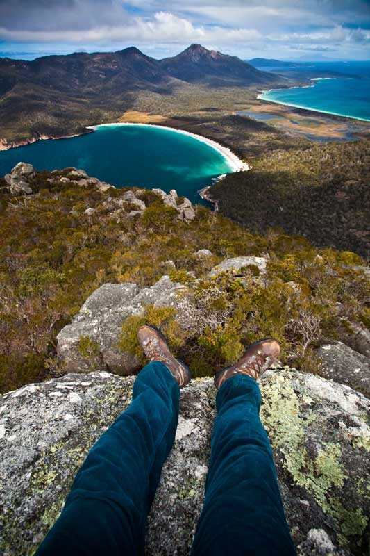 Wineglass Bay, TAS. This view is from the summit of Mt Amos, part of the granite mountains known as The Hazards. It is a strenuous three-hour return hike up. If you don't want to tackle it alone, consider a guided hike such as Travelwild Tasmania Tours.